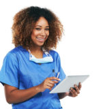 Studio portrait of an attractive young nurse using a digital tablet against a white background